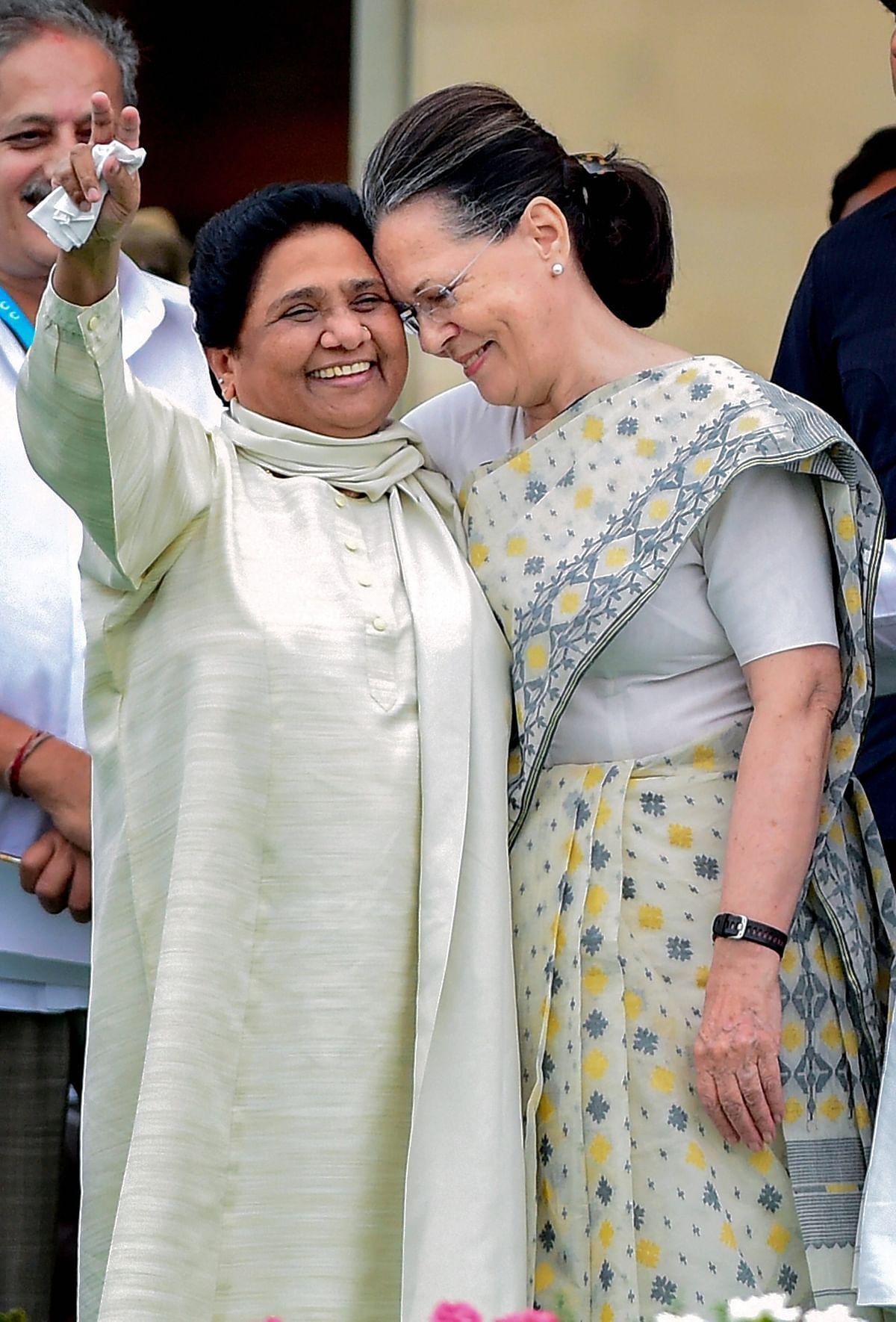 Sonia Gandhi and Mayawati share a hug.