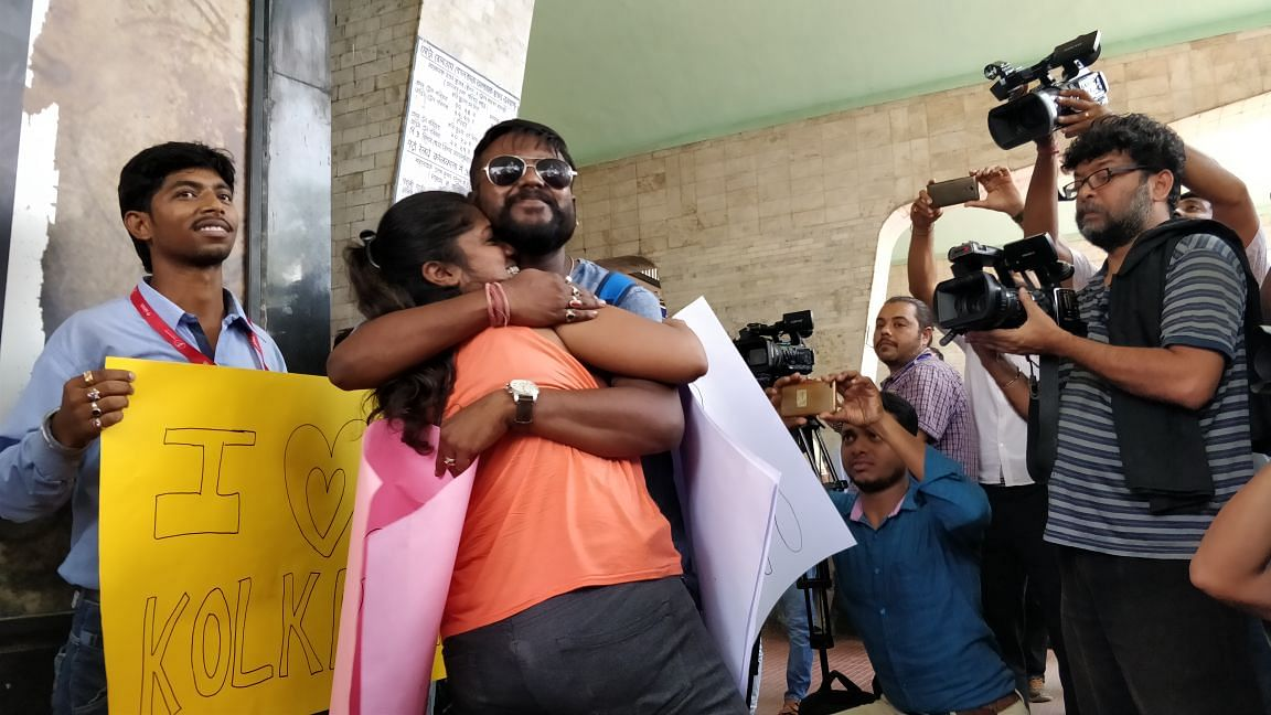 A couple hugs in public to protest Tuesday's incident where a mob allegedly attacked a boy and a girl for hugging.