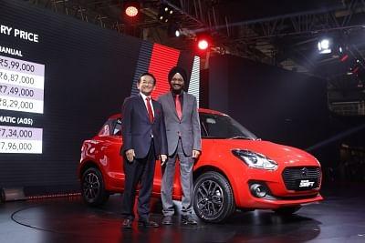 Greater Noida: Maruti Suzuki MD & CEO Kenichi Ayukawa and Sr. Executive Director, Marketing & Sales RS Kalsi Maruti Suzuki at launch of the third generation Swift at the Auto Expo 2018 in Greater Noida, Uttar Pradesh on Feb 8, 2018. (Photo: IANS)