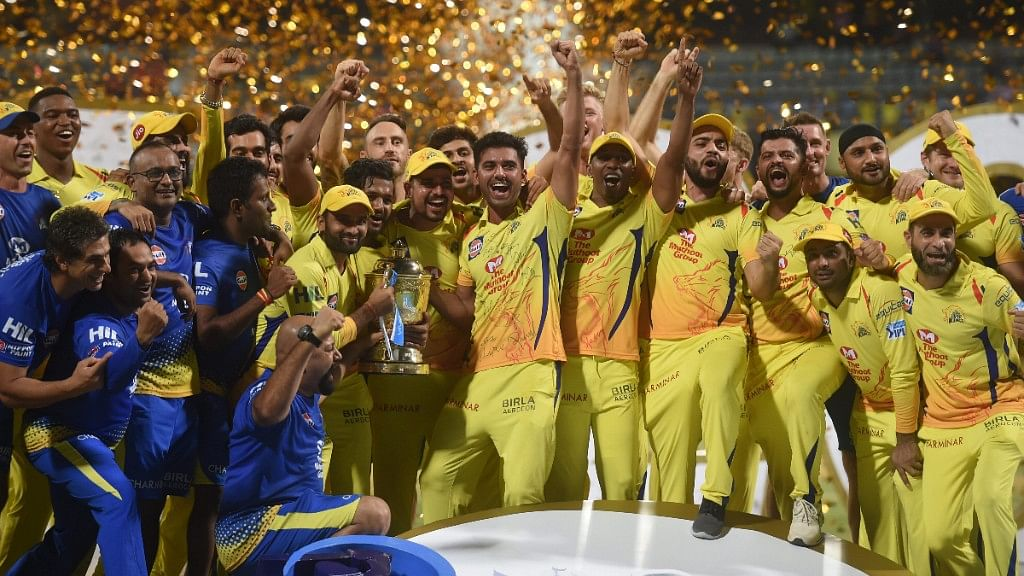 Chennai Super Kings players celebrate with the IPL 2018 trophy after winning the final match against Sunrisers Hyderabad, in Mumbai.