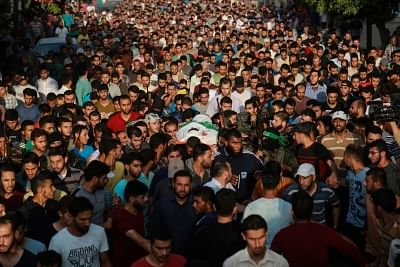 GAZA, May 28, 2018 (Xinhua) -- Mourners carry the body of Palestinian Mohamed al-Radee