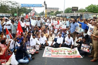 Chennai: CPI-M workers block road as they stage a demonstration against the death of civilians in police firing during anti-Sterlite protests in Tamil Nadu