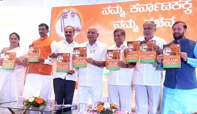Bengaluru: Karnataka BJP president B S Yeddyurappa releases party manifesto for the upcoming assembly election with Union Minister Prakash Javadekar, Karnataka BJP in-charge Muralidhar Rao, MP PC Mohan, MLAs Jagadish Shetter and Suresh Kumar in Bengaluru on May 4, 2018. (Photo: IANS)