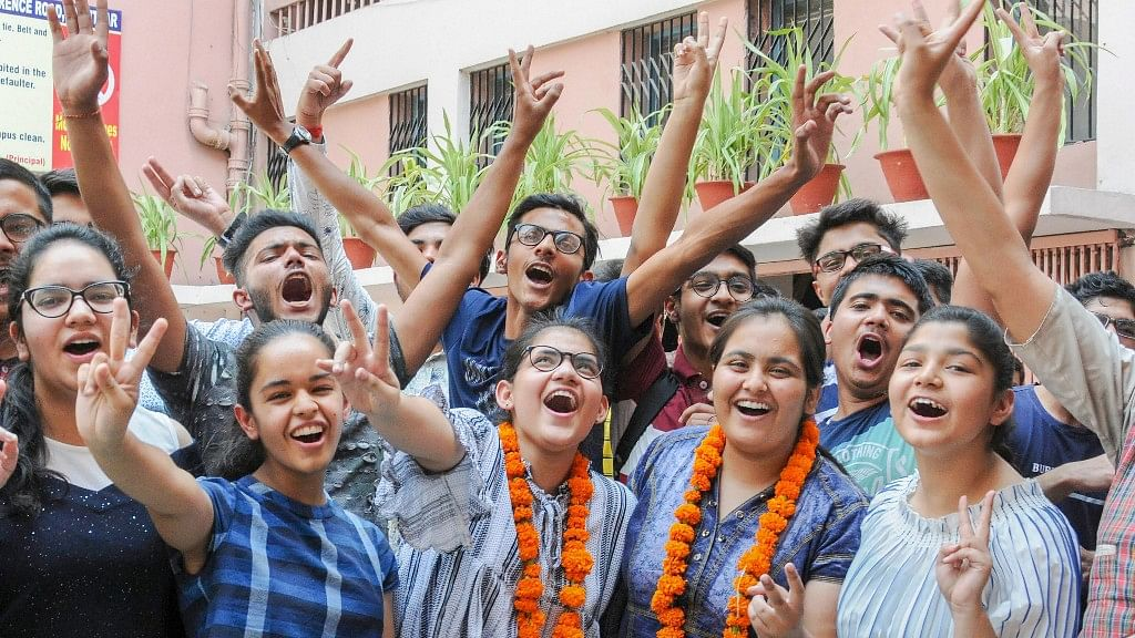 Students celebrate after the results of CBSE Class 10 were announced, in Amritsar.