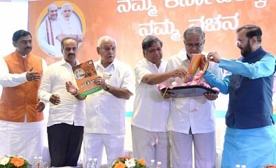 Bengaluru: Karnataka BJP president B S Yeddyurappa releases party manifesto for the upcoming assembly election with Union Minister Prakash Javadekar, Karnataka BJP in-charge Muralidhar Rao, MP PC Mohan, MLAs Jagadish Shetter and Suresh Kumar in Bengaluru on May 4, 2018. (Photo: IANS)