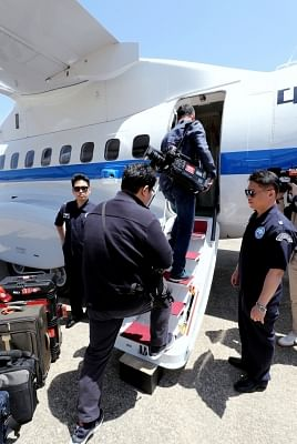 Seoul: South Korean journalists board a plane at Seoul Airport, just southeast of Seoul, on May 23, 2018, to go to North Korea where they will cover the dismantlement of the North