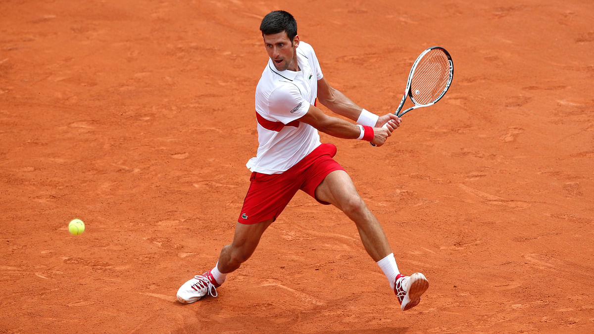Novak Djokovic launched his campaign for a second French Open title with a moody victory.