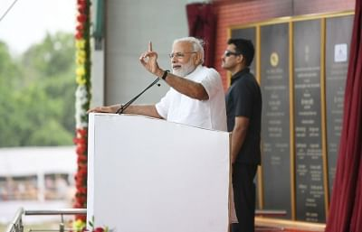 Sindri: Prime Minister Narendra Modi addresses at the foundation stone laying ceremony of several development projects in Sindri of Jharkhand on May 25, 2018. (Photo: IANS/PIB)