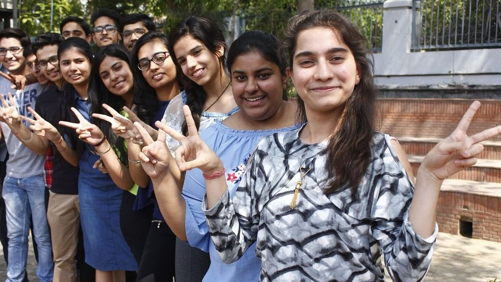 Students celebrate after the Central Board of Secondary Education (CBSE) declared results of the class 12 examinations, in Gurugram on 26 May 2018.