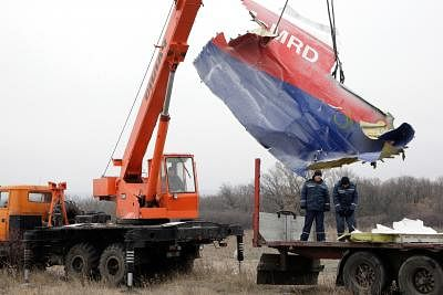 Donetsk (Ukraine) : Workers work on the site where the MH17 plane of Malaysia Airlines crashed, on the outskirts of Donetsk, eastern Ukraine, on Nov. 18, 2014. The recovery of the wreckage of flight MH17 will be completed in around five days, the Dutch Safety Board, leading the investigation into the crash in eastern Ukraine, announced on Monday. (Xinhua/Alexander Ermochenko/IANS)