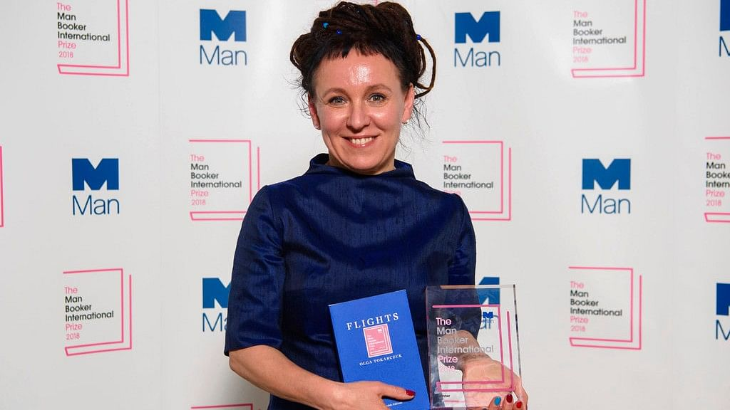 Polish author Olga Tokarczuk smiles after winning the Man Booker International prize 2018, Tuesday, 22 May, 2018, for her book Flights, at the Victoria and Albert Museum in London.
