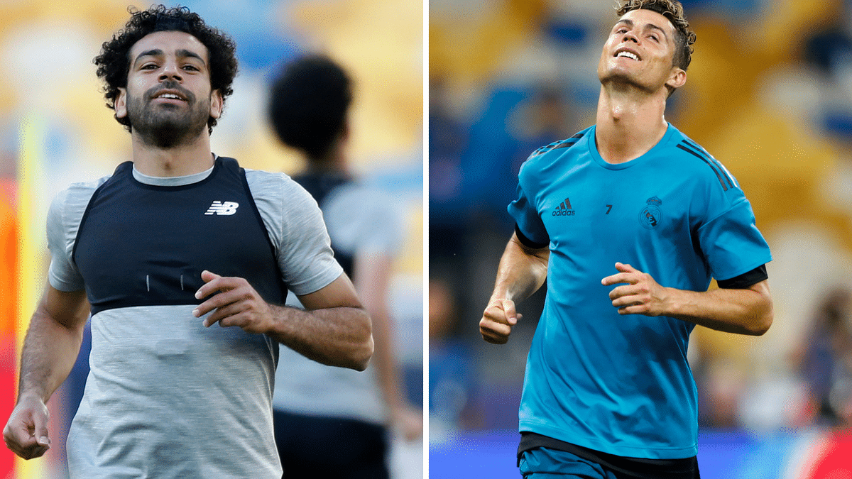 Liverpool's Mo Salah (left) and Real Madrid's Cristiano Ronaldo during practice sessions at the Olimpiyskiy Stadium in Kiev in Ukraine on Friday.