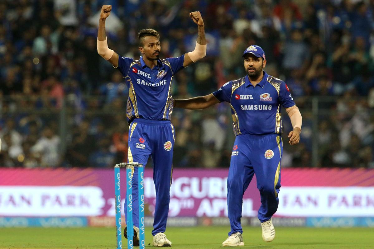 Hardik Pandya celebrates with Rohit Sharma.