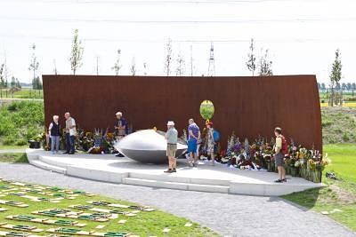 AMSTERDAM, July 18, 2017 (Xinhua) -- People mourn at the monument near Amsterdam Schiphol Airport in the province of North Holland, on July 18, 2017. Three years after the downing of Malaysian Airlines flight MH17 in eastern Ukraine, Dutch King Willem-Alexander inaugurated a monument forest on Monday in Vijfhuizen, near Amsterdam Schiphol Airport in the province of North Holland, to commemorate the 298 victims. (Xinhua/Sylvia Lederer/IANS)
