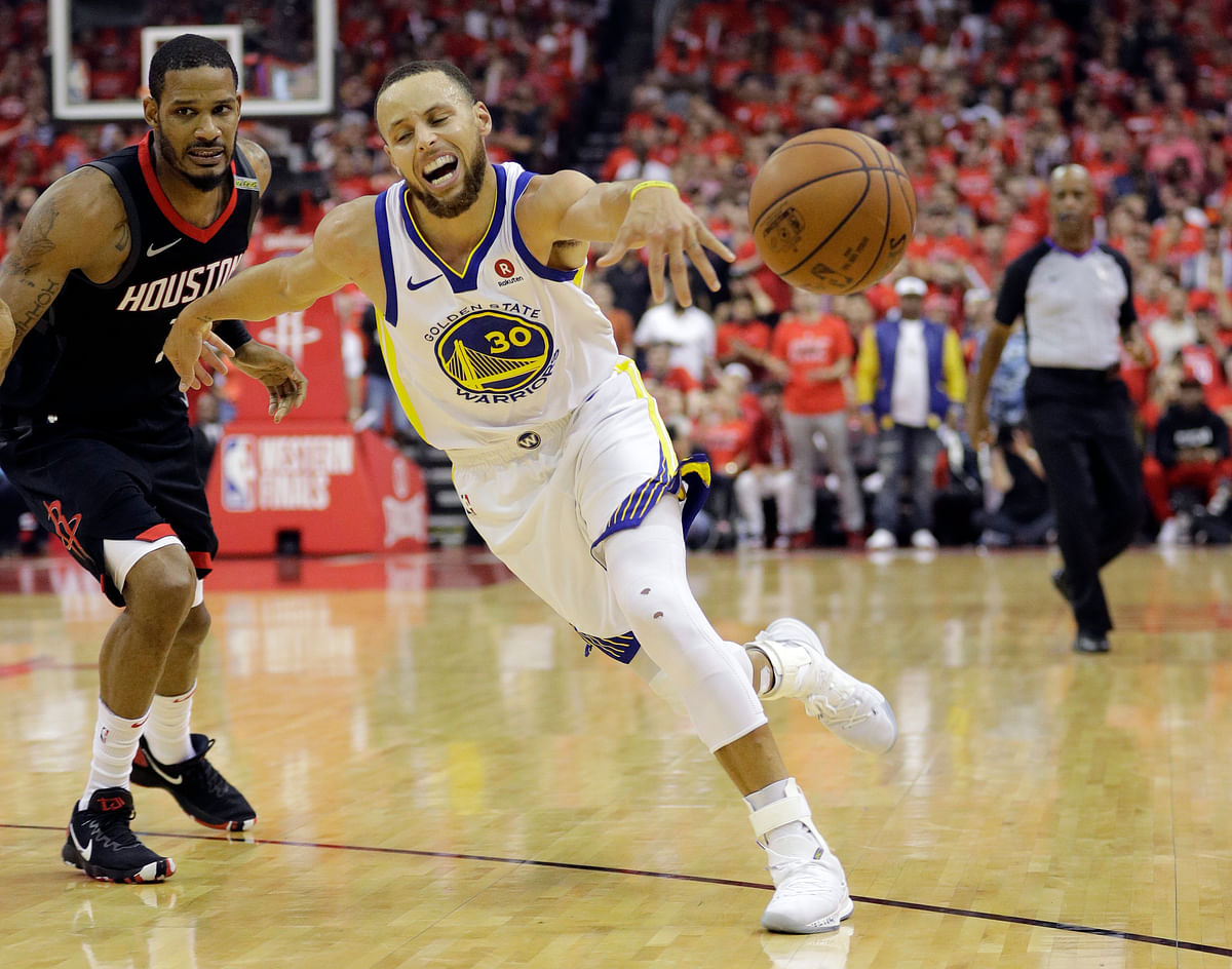 Golden State Warriors guard Stephen Curry (30) lose control of the ball as he drives around Houston Rockets forward Trevor Ariza (1) during the first half in Game 7 of the NBA basketball Western Conference finals, Monday, May 28, 2018, in Houston.