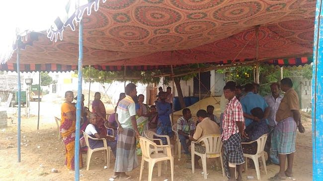 Ranjith's well wishers gather under the tent.