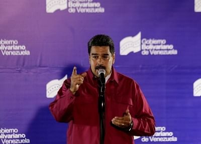 CARACAS, May 21, 2018 (Xinhua) -- Venezuelan President Nicolas Maduro delivers a speech during a press conference after casting his vote in a polling center in Caracas, Venezuela, on May 20, 2018. Nicolas Maduro was reelected for a second six-year term in the presidential election on Sunday, according to the National Electoral Council. (Xinhua/Boris Vergara/IANS)
