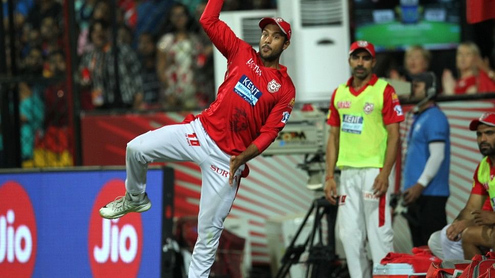 Mayank Agarwal throws the ball to Manoj Tiwary before going over the boundary rope.