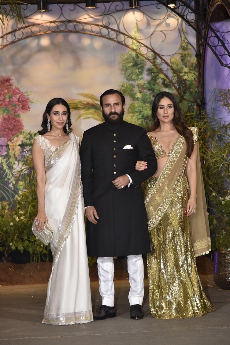 Saif Ali Khan arrives with Kareena and Karisma Kapoor.