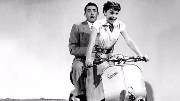 Audrey Hepburn with Gregory Peck  in 'Roman Holiday'.