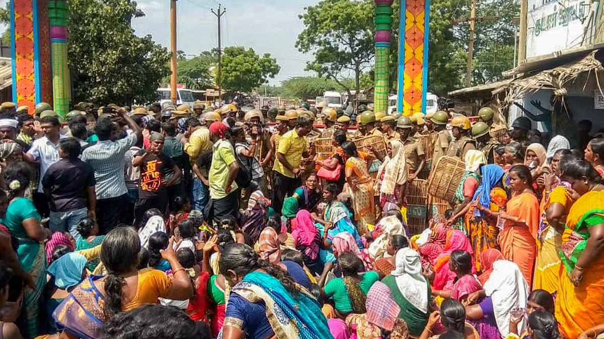 Police personnel tackle the agitators demanding the closure of Vedantas Sterlite Copper unit inThoothukudi, Tamil Nadu, as the protest enters the 100th day.