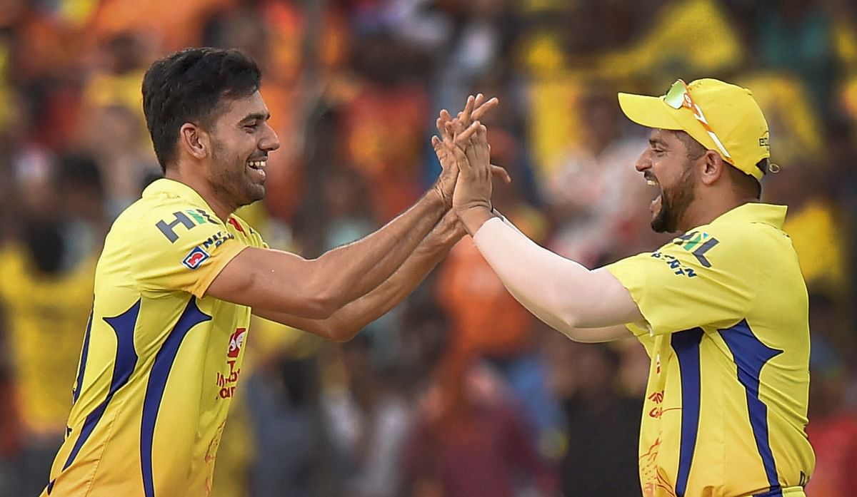 Deepak Chahar celebrates a wicket with Suresh Raina.