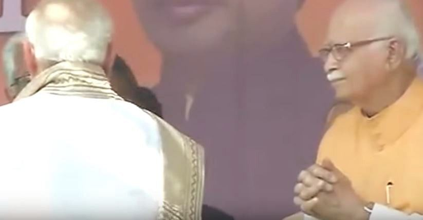 A screenshot (from the show 'Shut Up Ya Kunal') of L.K. Advani at an event as PM Modi passes him by.