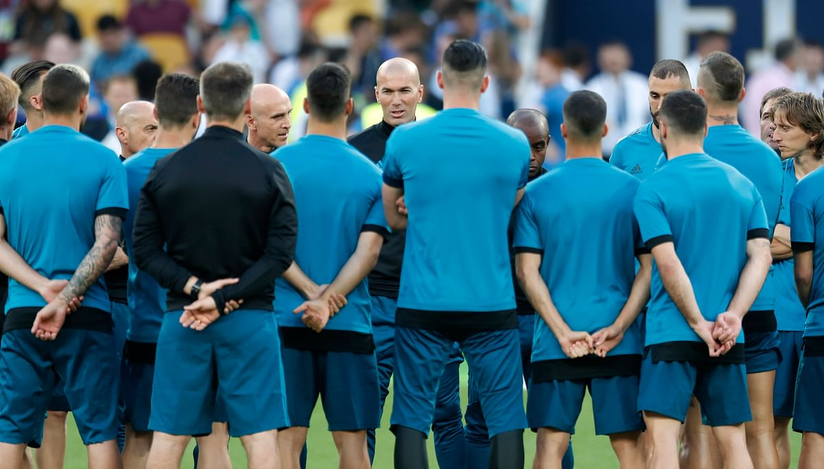 Real Madrid coach Zinedine Zidane talks to his players during a training session at the Olimpiyskiy Stadium in Kiev in Ukraine on Friday.