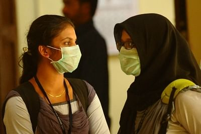 Kozhikode (Kerala): Students wear safety masks as a precautionary measure after the outbreak of