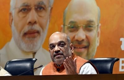New Delhi: BJP chief Amit Shah addresses a press conference on the fourth anniversary of Narendra Modi-led BJP government, at the party headquarter in New Delhi on May 26, 2018. (Photo: IANS)