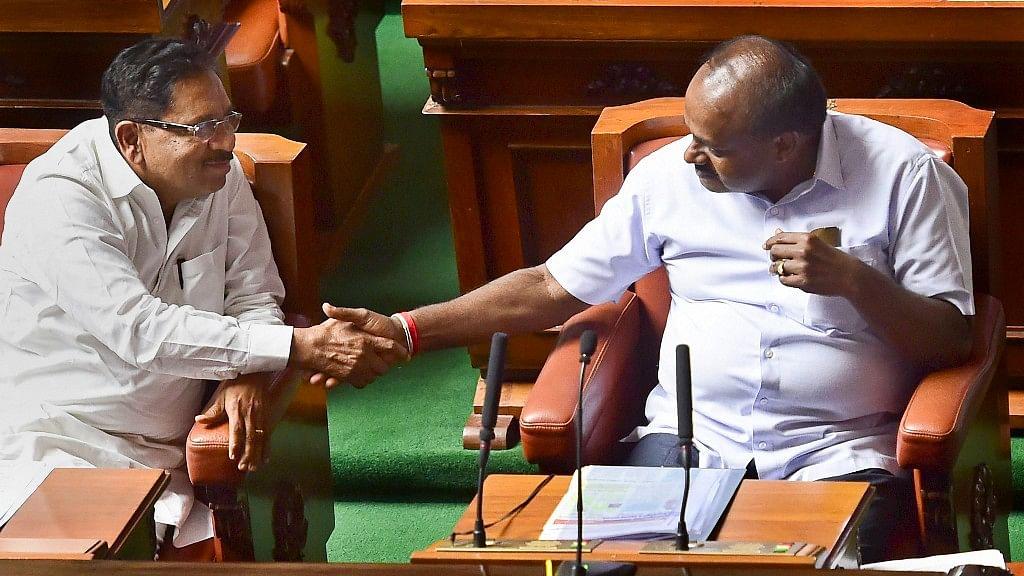 Karnataka Chief Minister HD Kumaraswamy (R) and his deputy G Parameshwara (L).