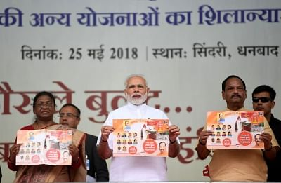 Sindri: Prime Minister Narendra Modi at the foundation stone of several development projects, in Sindri of Jharkhand on May 25, 2018. Also seen Jharkhand Governor Droupadi Murmu and Chief Minister Raghubar Das. (Photo: IANS/PIB)