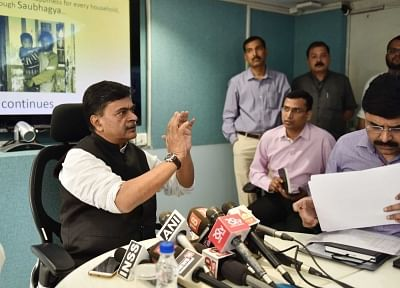 New Delhi: Union MoS Power and New and Renewable Energy Raj Kumar Singh addresses a press conference on the achievement of the target of 100 per cent village electrification; in New Delhi on May 1, 2018. (Photo: IANS/PIB)