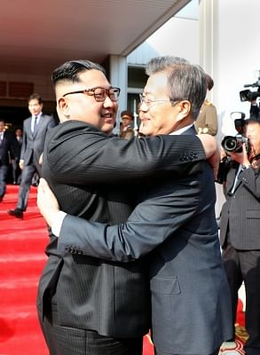 Panmunjom: In this photo provided by Cheong Wa Dae, North Korean leader Kim Jong-un (L) hugs South Korean President Moon Jae-in after their summit at Tongilgak on the northern side of Panmunjom in the Demilitarized Zone on May 26, 2018.(Yonhap/IANS)