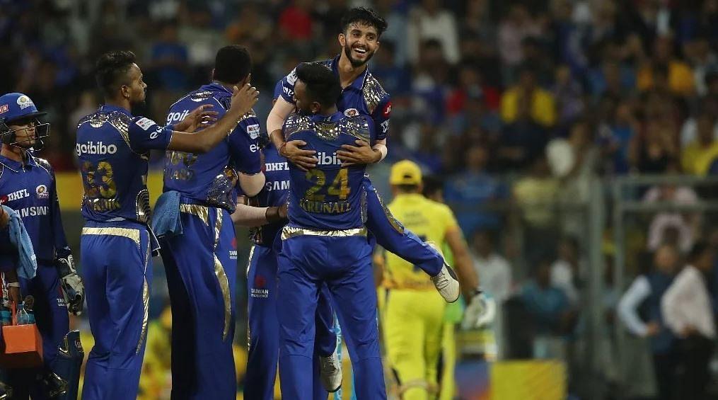 Mayank Markande celebrates a wicket with his teammates.