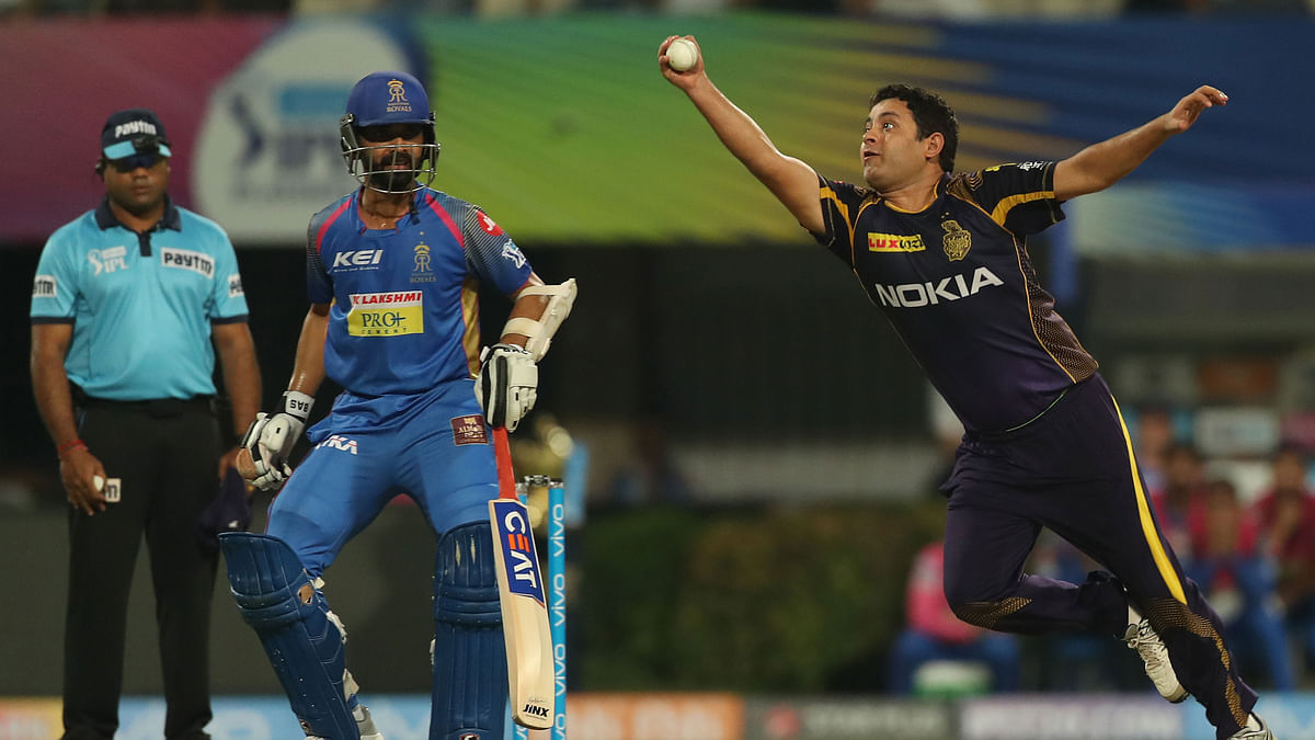 Piyush Chawla takes a catch to dismiss Rahul Tripathi off his own bowling.