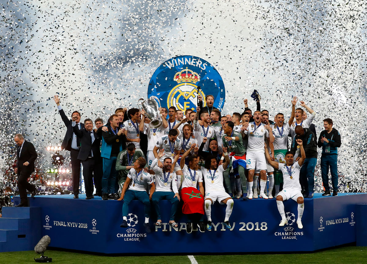 Real Madrid players celebrate with the trophy after winning the Champions League Final in Kiev.
