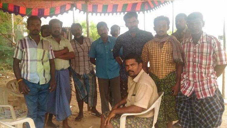 With a makeshift pandal pitched in puddles around the house, Ranjith Kumar's father sits down with a heavy heart.