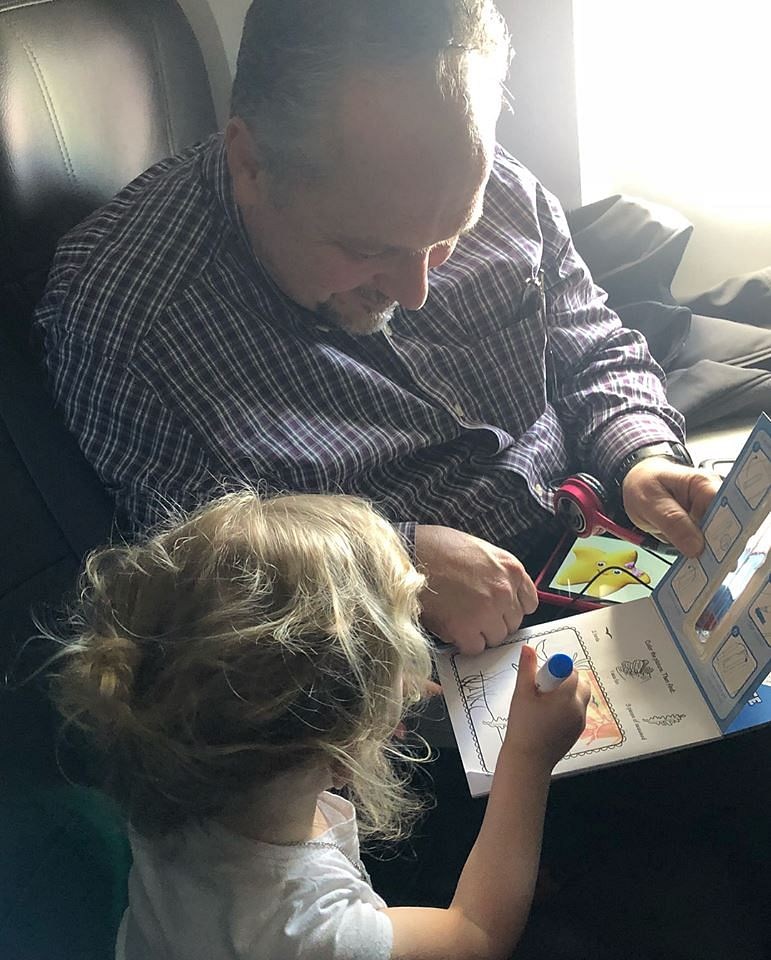 Caroline and Todd on a colouring spree on the plane