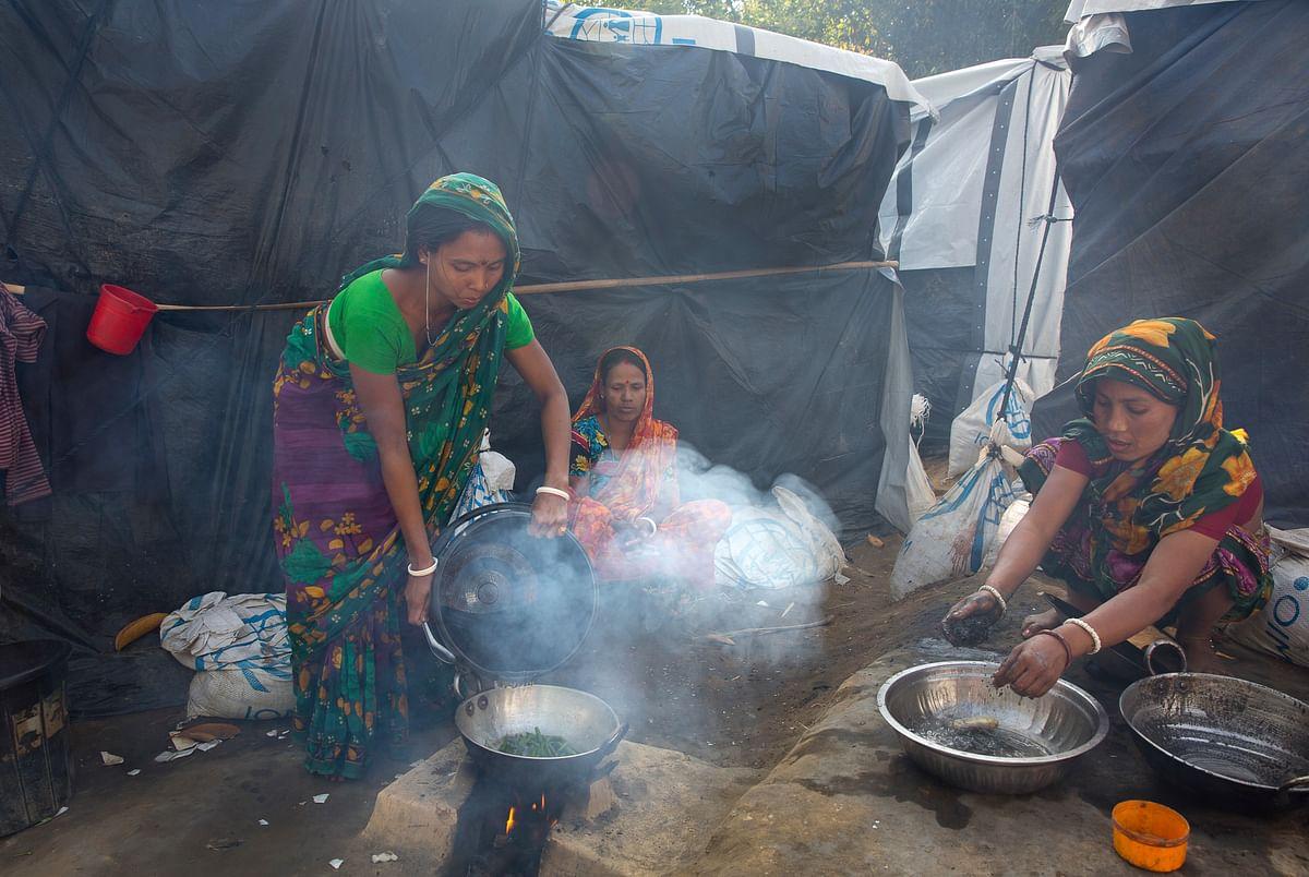 In this 19 January 2018, file photo, Hindu women refugees prepare supper at their camp near Cox's Bazar, Bangladesh.