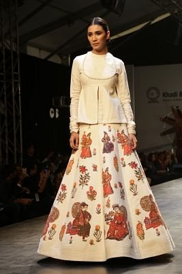 """New Delhi: A model showcases creation of fashion designer Rohit Bal collections at FDCI Fashion Show """"Khadi - Transcending Boundaries"""" in collaboration with KVIC as a part of SME Convention 2018 hosted by MSME, in New Delhi, on April 23, 2017. (Photo: Amlan Paliwal/IANS)"""