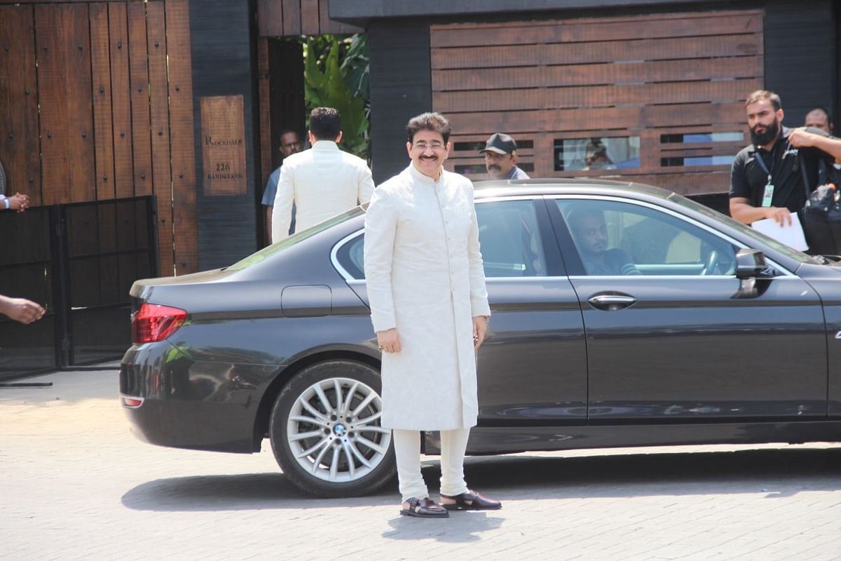 Mohit Marwah's father Sandeep Marwah arrives for the wedding.