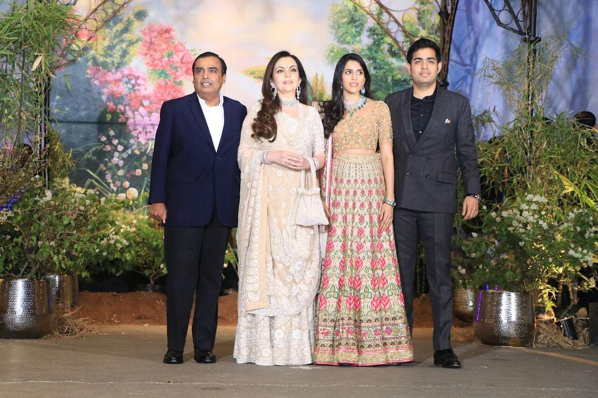 The Ambanis pose as a family.
