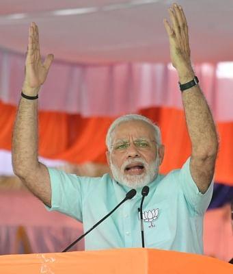 Chamarajanagar: Prime Minister and BJP leader Narendra Modi addresses during a party rally ahead of Karnataka assembly polls in Chamarajanagar, on May 1, 2018. (Photo: IANS)