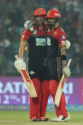India skipper Virat Kohl and AB de Villiers. (Photo: Surjeet Yadav/IANS)