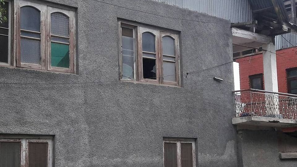 """Senior J&K police official posted pictures of broken windows, damaged cars and his home allegedly ransacked by """"security forces."""""""