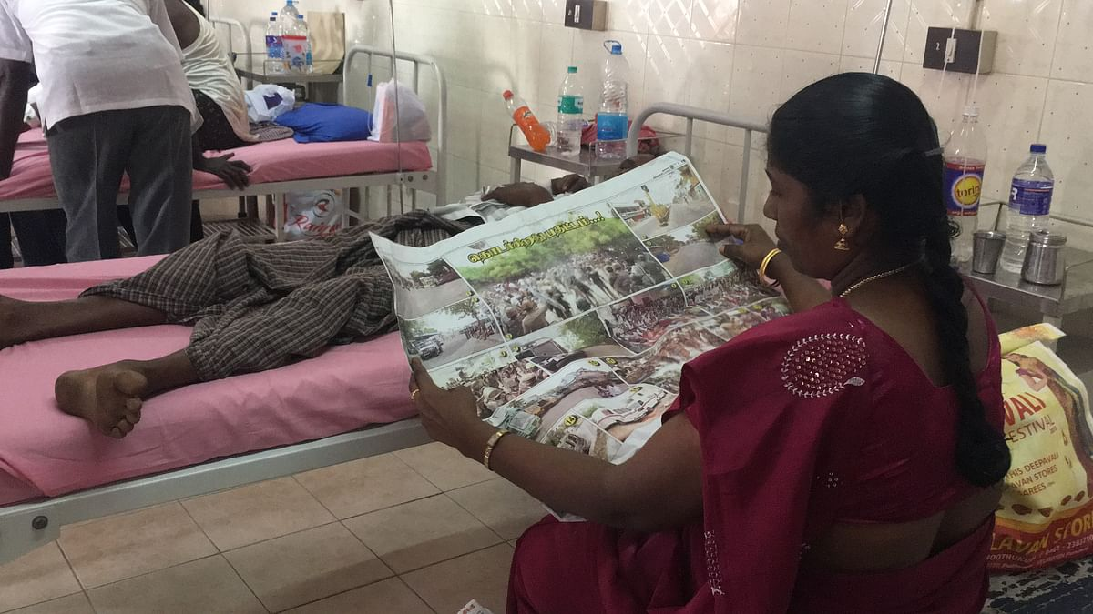 Amutha sits beside her husband who was shot in the protest. She says Sterlite has been terrorising them for years now.