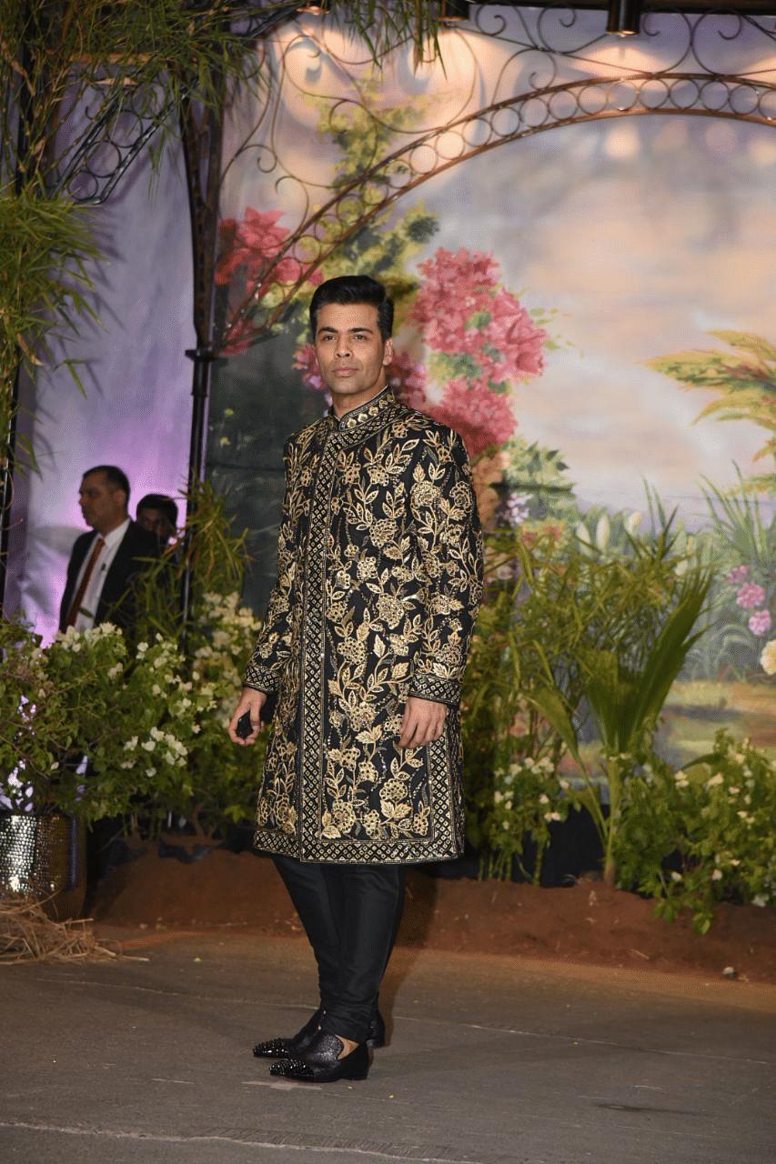 Karan Johar looked his party best.