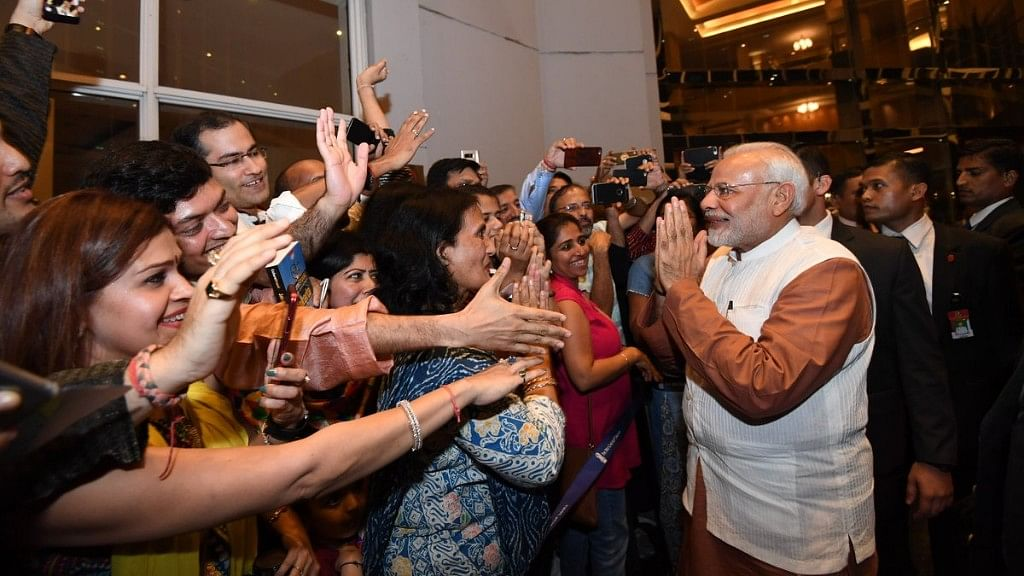 The Indian Community welcomes Prime Minister Narendra Modi at the airport in Indonesia.