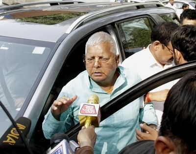 New Delhi: RJD chief Lalu Prasad Yadav arrives at New Delhi railway station in New Delhi on April 30, 2018.  He was on Monday shifted to a Ranchi hospital for follow-up treatment -- after he met Congress chief Rahul Gandhi at AIIMS where he was undergoing treatment for heart and kidney related ailments. Talking to reporters after being discharged, the RJD leader said shifting him back to the Ranchi hospital was a conspiracy so that his health would deteriorate further. But AIIMS spokesperson B.N